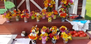 Tin can bouquets and larger vase arrangements