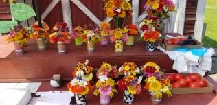 Tin can bouquets and larger vase arrangements